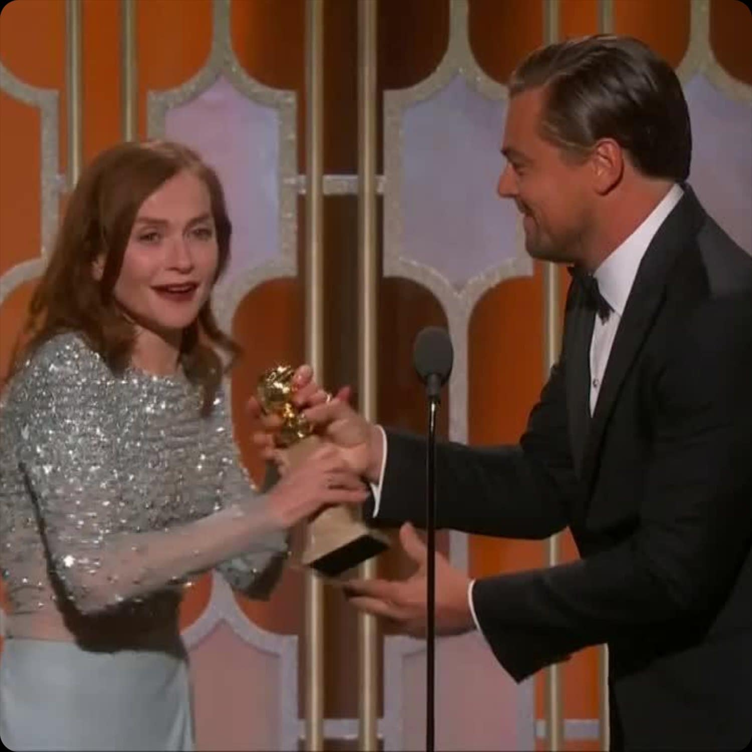 Isabelle Huppert receives Golden Globe from Leonardo DiCaprio